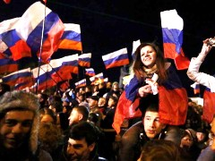 Crimea separates from Ukraine returns to Russia referendum 2014 happy people celebrations crowd Russian flags